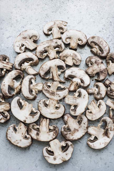 Sliced champignon mushrooms — Stock Photo