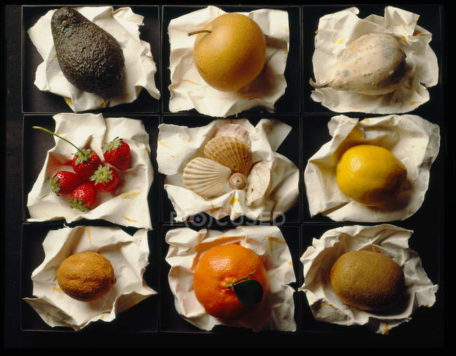 Top view of different fruits on tray on table — Stock Photo
