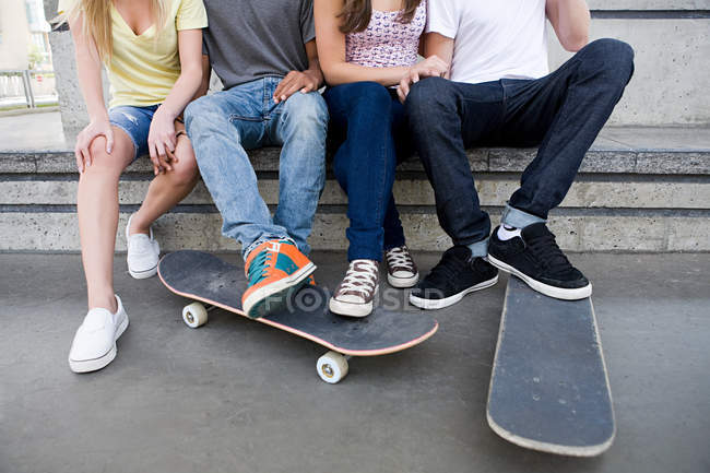 Cropped image of Teenagers with skateboards at skate-park — Stock Photo