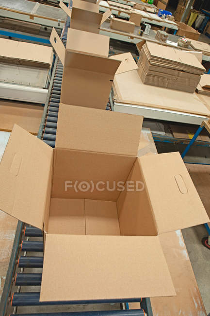 Empty boxes on conveyor — Stock Photo