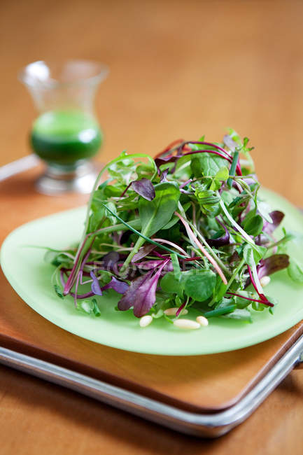 Fresh green salad served on table — Stock Photo