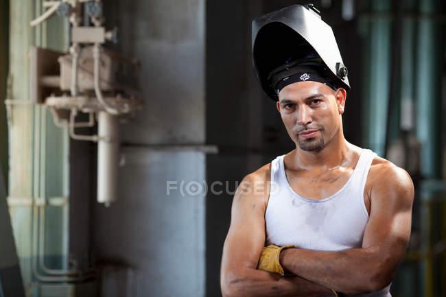 Industrial worker in welding helmet — Stock Photo