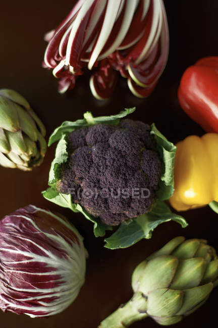 Variety of vegetables with globe artichokes, peppers, broccoli and cabbage — Stock Photo