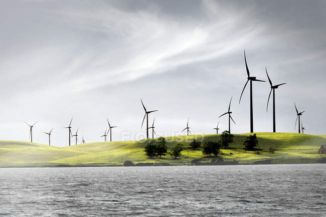 Windmills on green hills — Stock Photo
