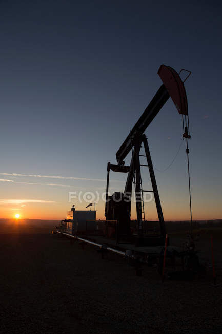 Oil well silhouette — Stock Photo