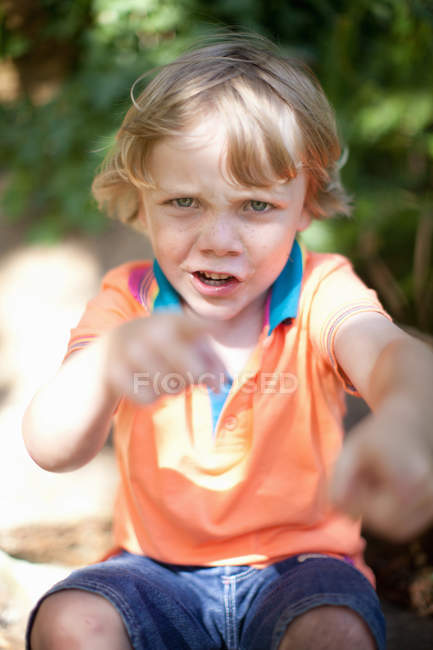 Boy punching the air outdoors — Stock Photo