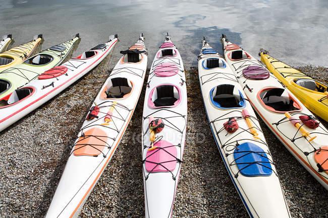 Kayaks moored on sandy beach — Stock Photo