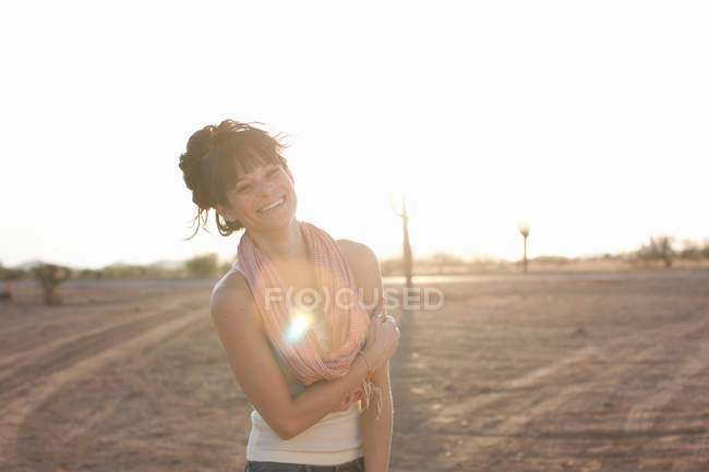 Young woman standing in desert, portrait — Stock Photo