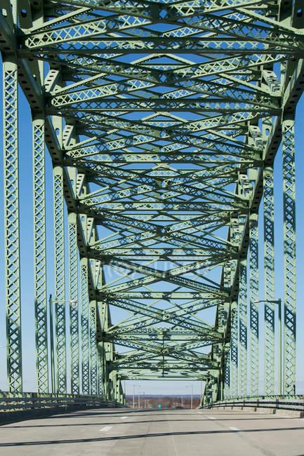 Steel structure of bridge in bright sunlight — Stock Photo