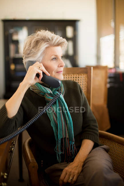 Senior woman on landline phone — Stock Photo