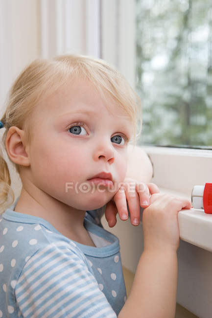 Portrait of Girl with asthma inhaler — Stock Photo