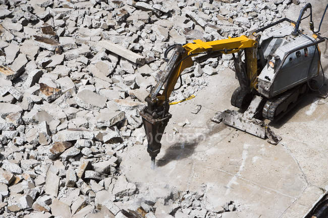 Pneumatic drill breaking concrete — Stock Photo