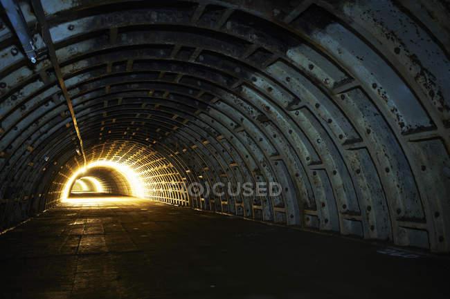 Light illuminating end of underground tunnel — Stock Photo