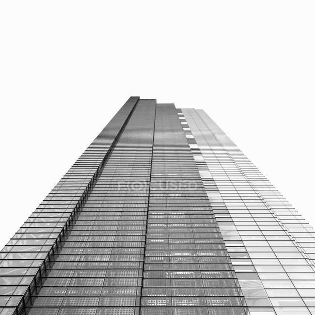 Low angle view of modern skyscraper, black and white — Stock Photo