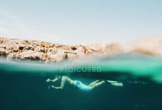Underwater surface view of mature man sea snorkeling, Menorca, Balearic islands, Spain — Stock Photo