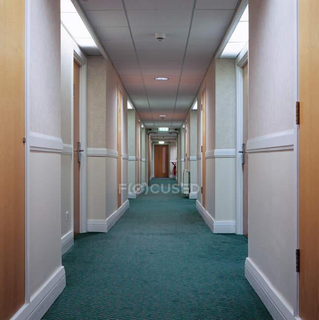 Front view of illuminated hotel corridor — Stock Photo