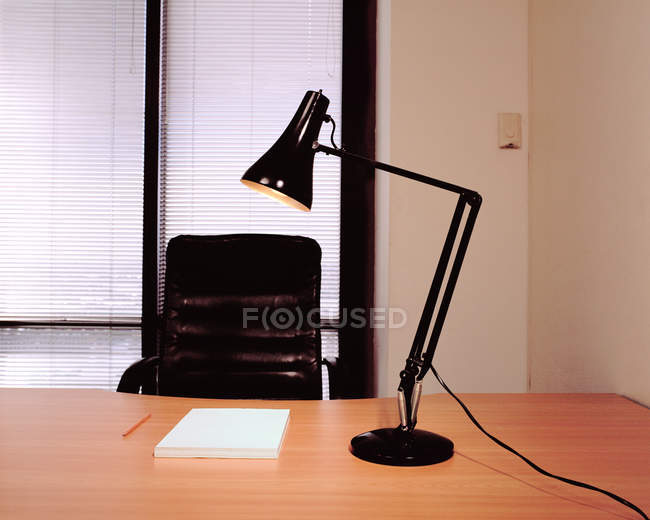 Empty office with chair and lamp — Stock Photo