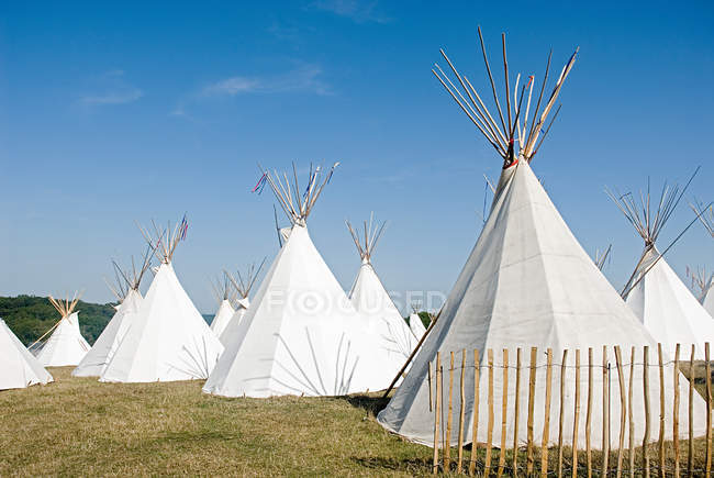 White teepees in field — Stock Photo