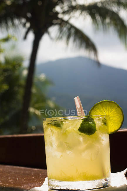 Citrus cocktail with straw — Stock Photo