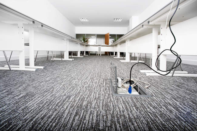 Empty presentation room with cables — Stock Photo