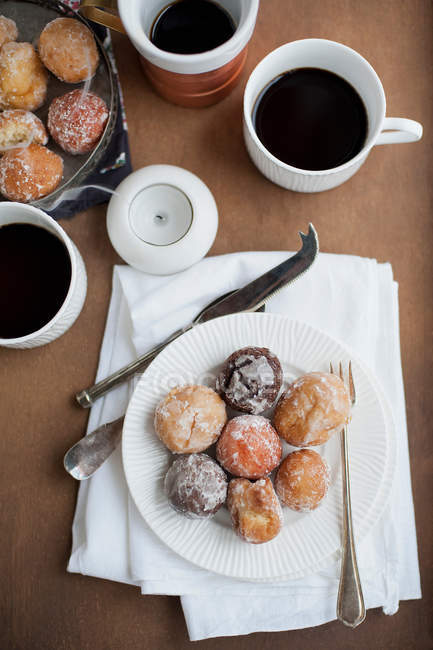 Plate with desserts and coffee — Stock Photo