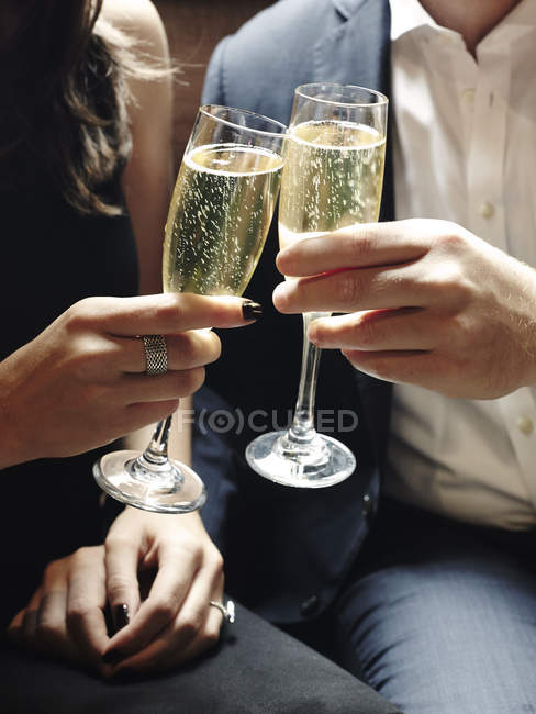 Man and woman with champagne glasses — Stock Photo