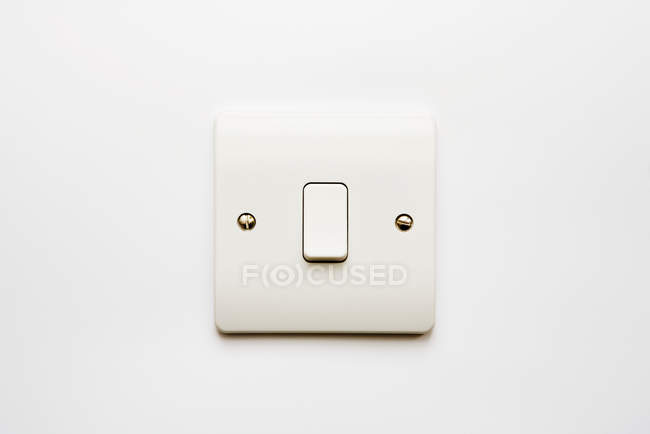 Minimalistic light switch on white wall — Stock Photo