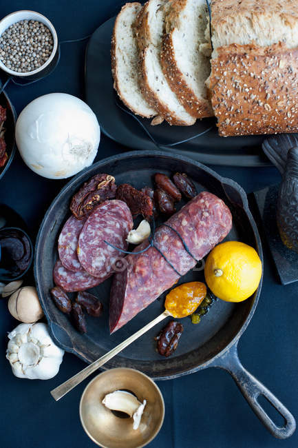 Salami with lemon and bread — Stock Photo