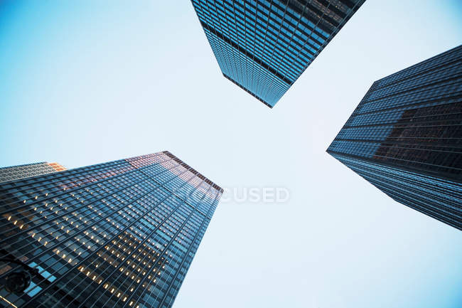 View of three skyscrapers from below — Stock Photo