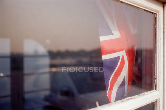 Union Jack flag seen through window glass — Stock Photo
