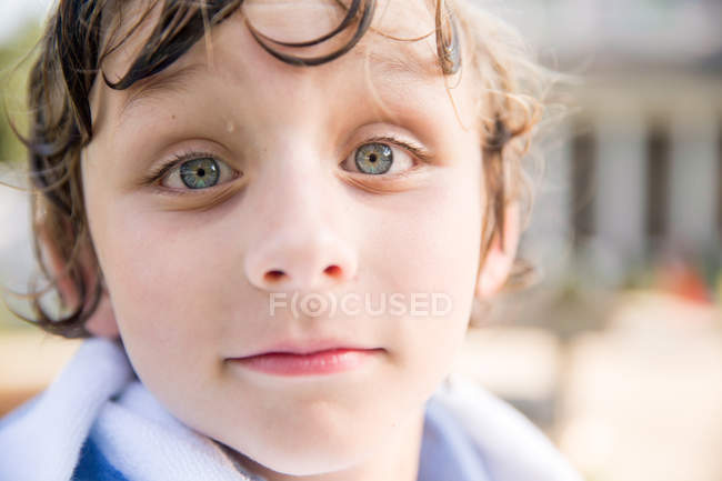 Close up portrait of boy with wet hair — Stock Photo