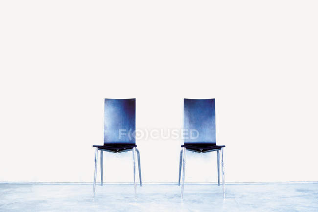 Front view of two empty modern chairs — Stock Photo