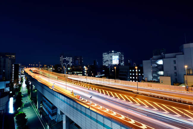 Light trails on highway at night, Tokyo, Japan — Stock Photo