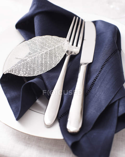 High angle view of knife fork and napkin on place setting — Stock Photo