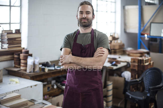 Portrait of man in wooden products factory — Stock Photo