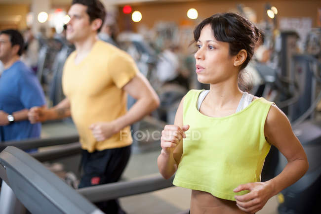 People using treadmills in gym — Stock Photo
