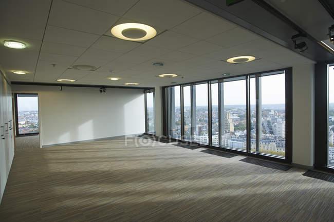 Empty skyscraper office interior with city view — Stock Photo