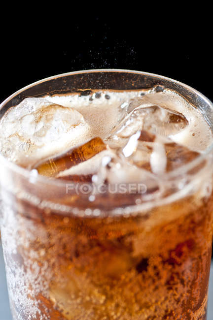 Cola drink with ice cubes in glass — Stock Photo