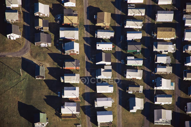 Aerial view of sun lighted houses in a row — Stock Photo