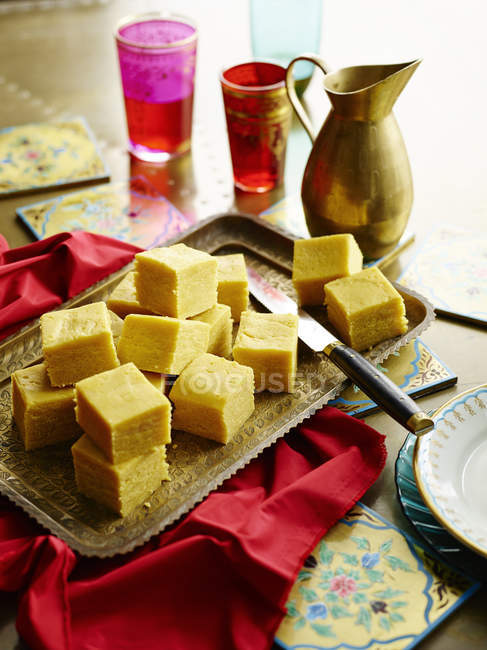 Appetizing besan ki burfi pieces on table — Stock Photo