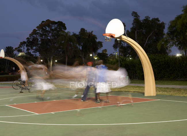 Basketball players at night, blurred motion — Stock Photo