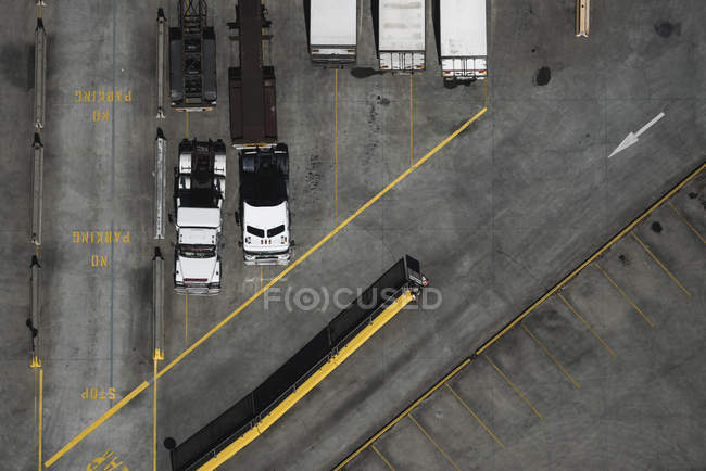 Aerial view of parked trucks in bright sunlight — Stock Photo