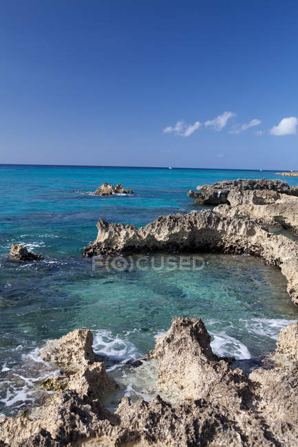Rocks and Caribbean Sea, Grand Cayman, Cayman Islands ... on nassau caribbean, saint-martin caribbean, belize caribbean, cooper island caribbean, caicos caribbean, pennsylvania caribbean, windward islands caribbean, el salvador caribbean, eustatius caribbean, union island caribbean, monaco caribbean, anegada caribbean, virgin islands caribbean, guam caribbean, dominica island caribbean, jamaica caribbean, peter island caribbean, guatemala caribbean, chile caribbean, st barts caribbean,
