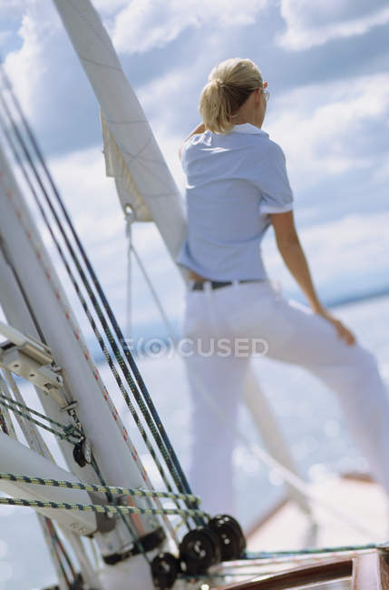 Rear view of woman on boat looking out to sea — Stock Photo