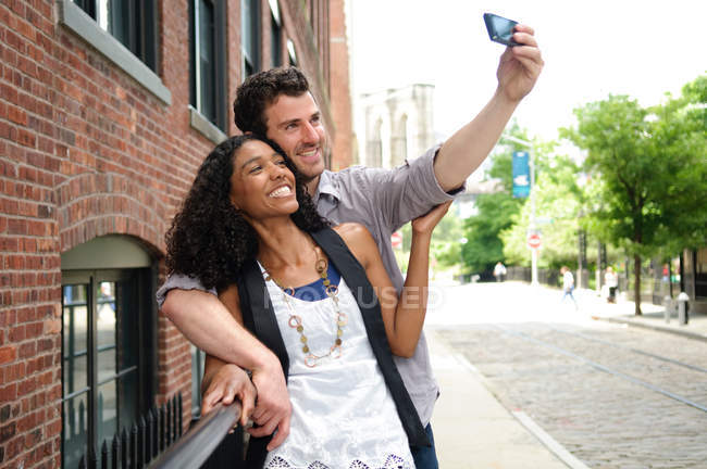 Couple taking a picture of themselves — Stock Photo