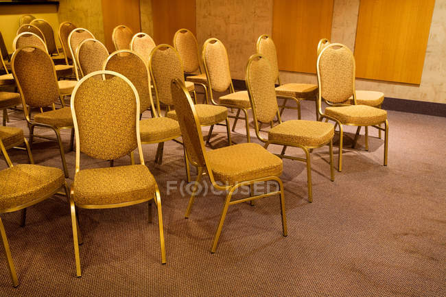 Set of vintage design chairs in empty room — Stock Photo