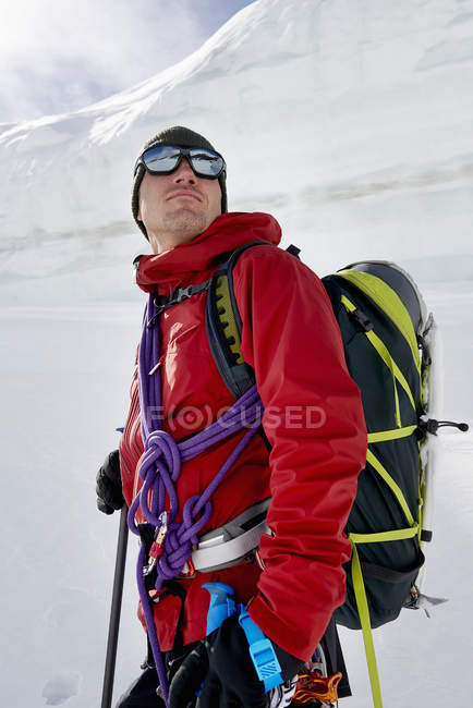 Portrait of man with mountaineering equipment looking away — Stock Photo