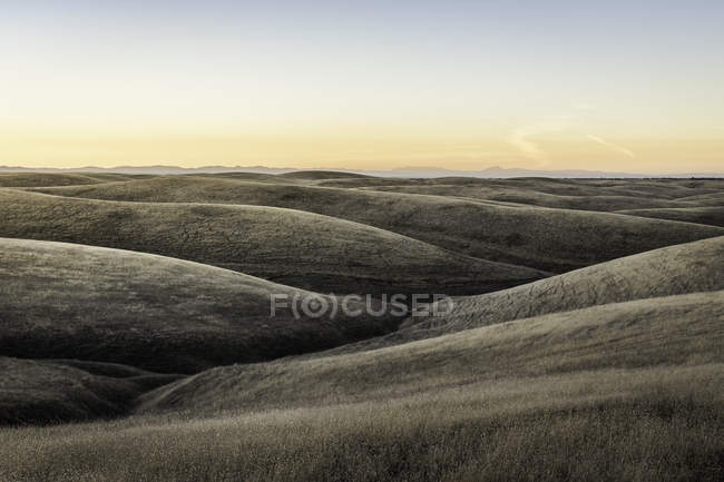 Landscape view of rolling prairie hills at sunset — Stock Photo