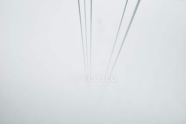 Cable car cables disappearing into mist, Mount Pilatus, Switzerland — Stock Photo