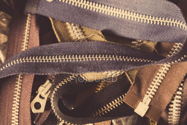 Close-up of pile of zips, in leather jacket manufacturers — Stock Photo
